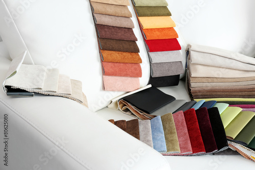 Scraps of colored tissue on sofa close up - 80625080