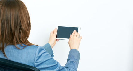 Portrait Back. Business Woman Working with tablet, finger touch