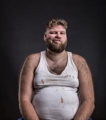 Fat man with beard in dirty shirt