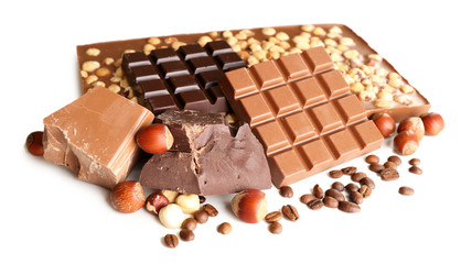 Chocolate bars with hazelnuts and coffee beans isolated on