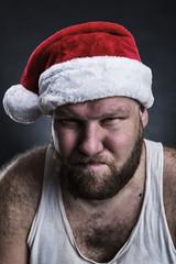 Pensive man in Santa Claus hat