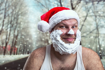 Smiling man in Santa Claus hat