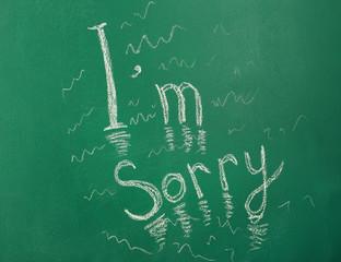 I am Sorry written with chalk on blackboard