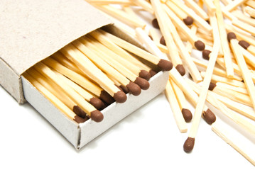 matchbox and matches on white