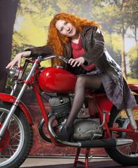 Redhead girl on motorbike