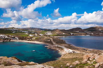Top view of the Kalafatis beach of Mykonos against a beautiful s