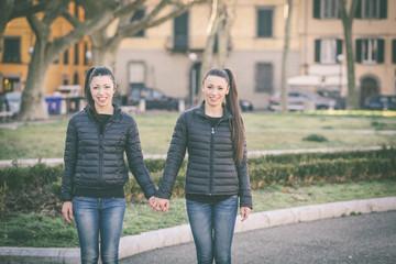 Female twins portrait at park