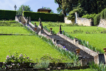 Staircase with sculptures and irises in the gardens Bardini