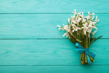 Snowdrops on blue wooden background