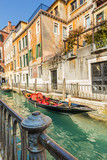 Fototapeta Lovely canal with gondola in Venice
