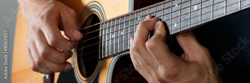 Acoustic guitar player performing song - 80631657