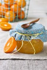 jar with tangerine jam on a linen napkin