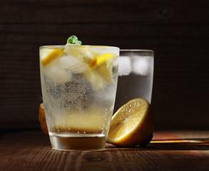 Cold fresh lemonade on the woden table