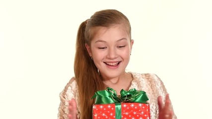 Girl stands with her eyes closed, opening them she sees box gift