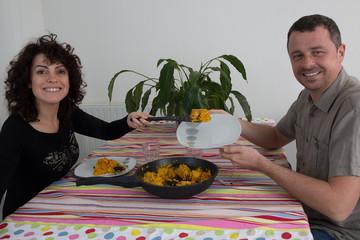 European Couple Enjoying indoor Meal