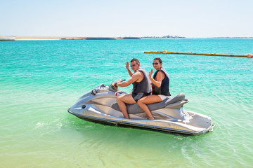 Couple on the jetski at the beach of Abu Dhabi, UAE