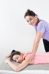 Beautiful woman enjoying massage and body treatment