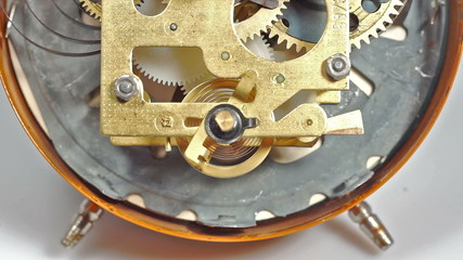 Mechanical clock mechanism in action. Two clips in one.