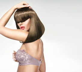 Fashionable shot of the female model with trendy coiffure