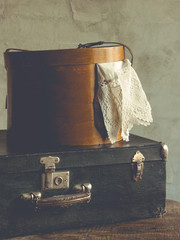 Old suitcase and a box of clothes