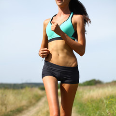 Woman Runner. Fitness Girl Running outdoors