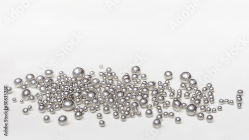 Pure silver granules on a white background - 80635280