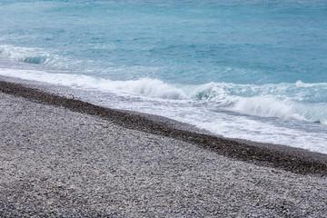 Coast of the Mediterranean Sea, line of a surf. Cloudy spring da
