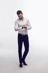 Fashion man checking the time