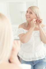 Woman looks at her reflection