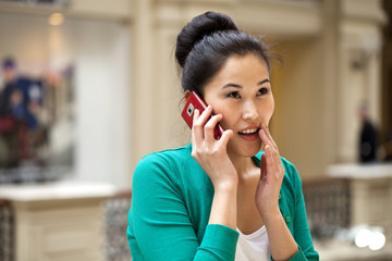 Beautiful asian calling by mobile phone