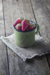 Ripe sweet strawberries in pot