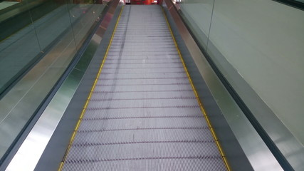 Modern escalator moving up at business, shopping center, airport