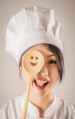 Happy Chef Covering One Eye with Wooden Ladle