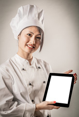 Young Female Chef Holding Tablet with Blank Screen