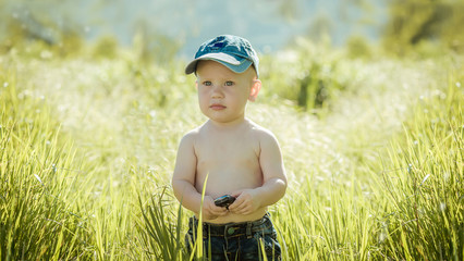 little boy on the lawn,