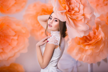 Portrait of young beautiful girl in paper flowers