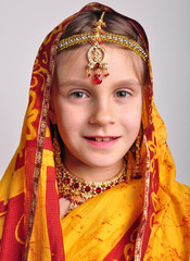 little girl in traditional Indian sari and jeweleries
