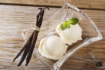 ball of vanilla ice cream on a plate