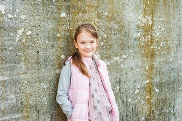 Outdoor portrait of adorable little girl of 7 years old