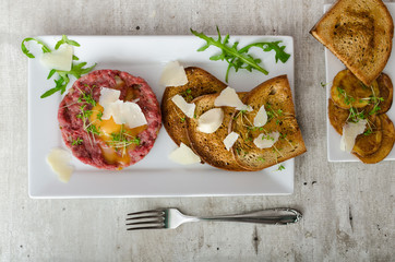 Beef tartar, toast bread with garlic