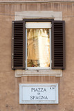 Piazza di Spagna sign on historic italian building in Rome
