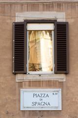 Piazza di Spagna sign on historic italian building in Rome