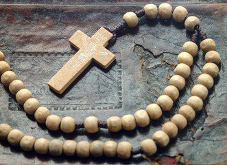 wooden rosary on the book