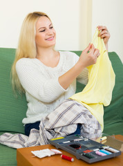 Housewife stitching tears of clothes