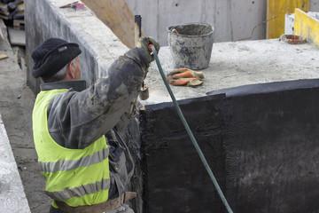 Insulation worker melting bitumen felt 2