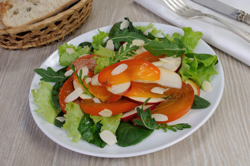 Salad greens with persimmon and almonds