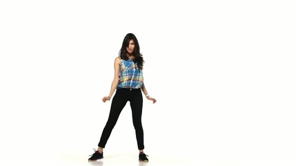 Young dancing lady style woman in plaid shirt on white