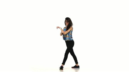 Young dancing lady style brunette woman in plaid shirt on white