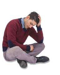 Depressed man sitting on the floor with head in his hand