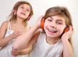 two little girls with headphones  listening to music